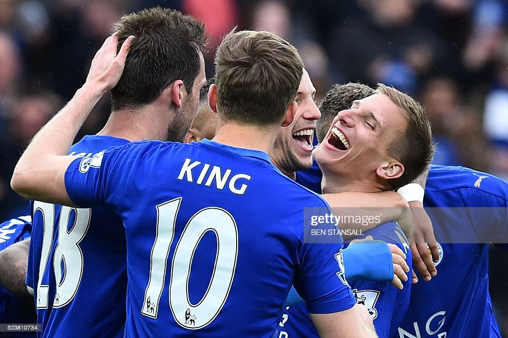 Leicester City's English midfielder Marc Albrighton (R) celebrates scoring their fourth goal during the English Premier League football match between Leicester City and Swansea at King Power Stadium in Leicester, central England on April 24, 2016. / AFP / BEN STANSALL / RESTRICTED TO EDITORIAL USE. No use with unauthorized audio, video, data, fixture lists, club/league logos or 'live' services. Online in-match use limited to 75 images, no video emulation. No use in betting, games or single club/league/player publications. /