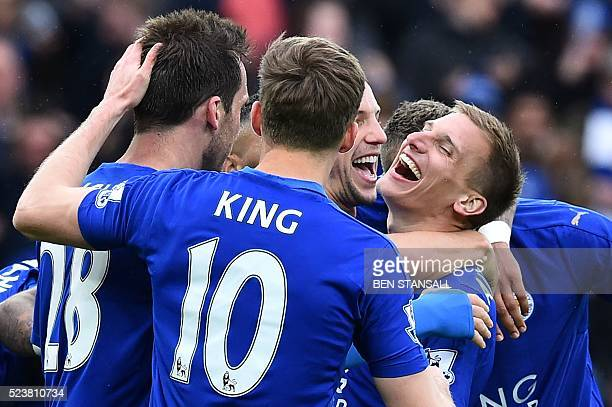 Leicester City's English midfielder Marc Albrighton celebrates scoring their fourth goal during the English Premier League football match between...