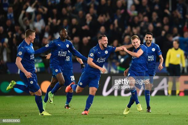 TOPSHOT Leicester City's English midfielder Marc Albrighton celebrates scoring their second goal with teammate Leicester City's English midfielder...