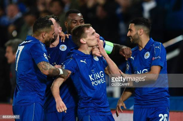 Leicester City's English midfielder Marc Albrighton celebrates scoring their second goal during the UEFA Champions League round of 16 second leg...