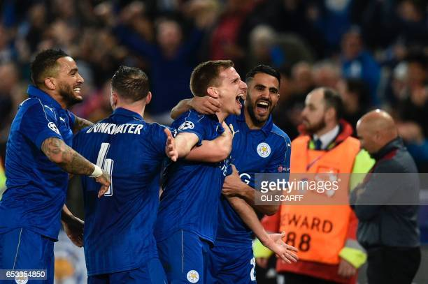 TOPSHOT Leicester City's English midfielder Marc Albrighton celebrates scoring their second goal during the UEFA Champions League round of 16 second...