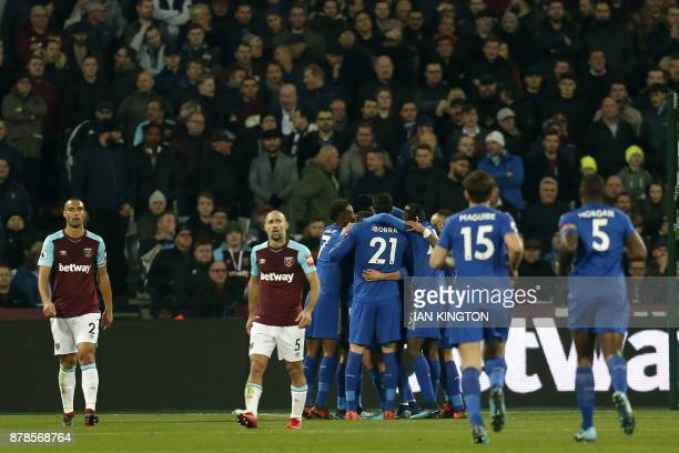 Leicester City's English midfielder Marc Albrighton celebrates with teammates scoring the first goal as West Ham United's New Zealand defender...
