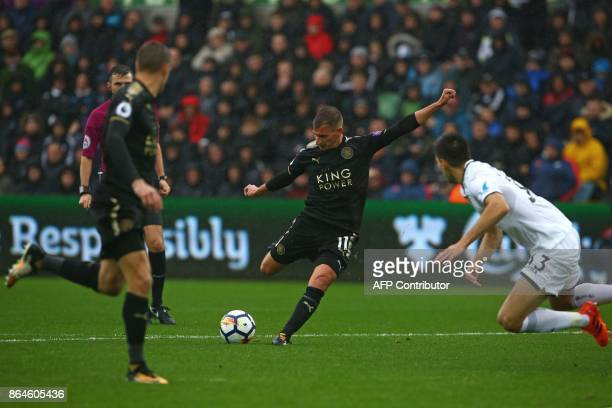 Leicester City's English midfielder Marc Albrighton lines up a shot during the English Premier League football match between Swansea City and...