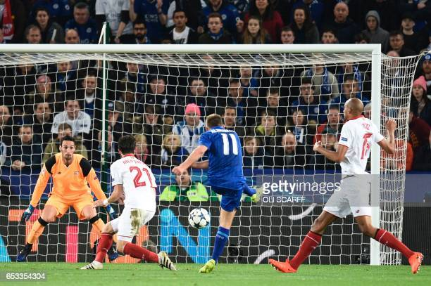 TOPSHOT Leicester City's English midfielder Marc Albrighton scores their second goal during the UEFA Champions League round of 16 second leg football...