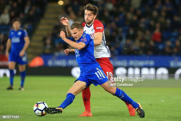 Leicester City's English midfielder Marc Albrighton vies with West Bromwich Albion's English striker Jay Rodriguez during the English Premier League...