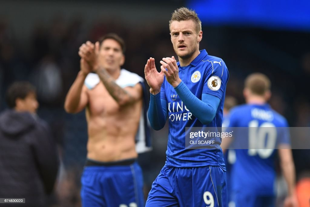 Leicester City's English striker Jamie Vardy applauds supporters after the English Premier League football match between West Bromwich Albion and Leicester City at The Hawthorns stadium in West Bromwich, central England, on April 29, 2017. Vardy scored the only goal as Leicester won the game 1-0. / AFP PHOTO / Oli SCARFF / RESTRICTED TO EDITORIAL USE. No use with unauthorized audio, video, data, fixture lists, club/league logos or 'live' services. Online in-match use limited to 75 images, no video emulation. No use in betting, games or single club/league/player publications. /