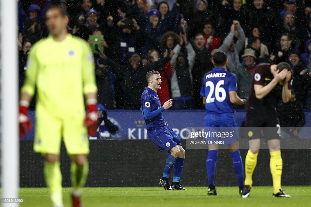 Leicester City's English striker Jamie Vardy (2nd L) celebrates after scoring his third goal, their fourth as Manchester City's Chilean goalkeeper Claudio Bravo (L) and Manchester City's English defender John Stones (R) react during the English Premier League football match between Leicester City and Manchester City at King Power Stadium in Leicester, central England on December 10, 2016. / AFP / Adrian DENNIS / RESTRICTED TO EDITORIAL USE. No use with unauthorized audio, video, data, fixture lists, club/league logos or 'live' services. Online in-match use limited to 75 images, no video emulation. No use in betting, games or single club/league/player publications. /