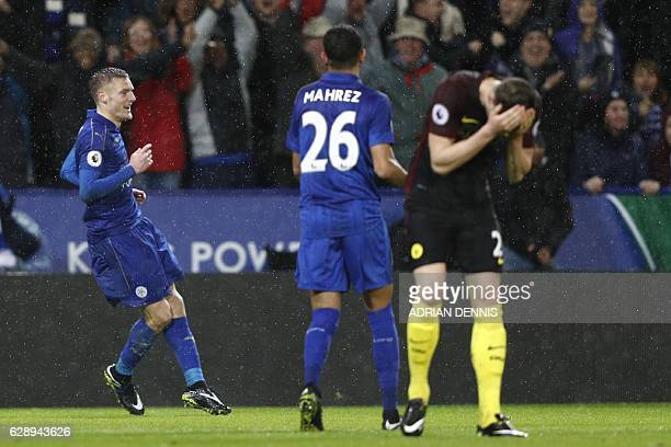 Leicester City's English striker Jamie Vardy celebrates after scoring his third goal their fourth as Manchester City's English defender John Stones...