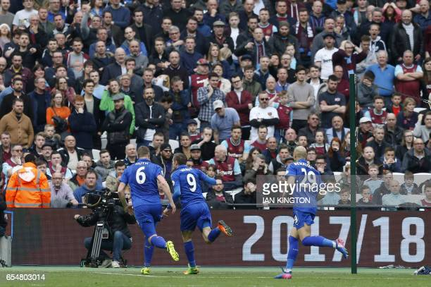 Leicester City's English striker Jamie Vardy celebrates after scoring during the English Premier League football match between West Ham United and...
