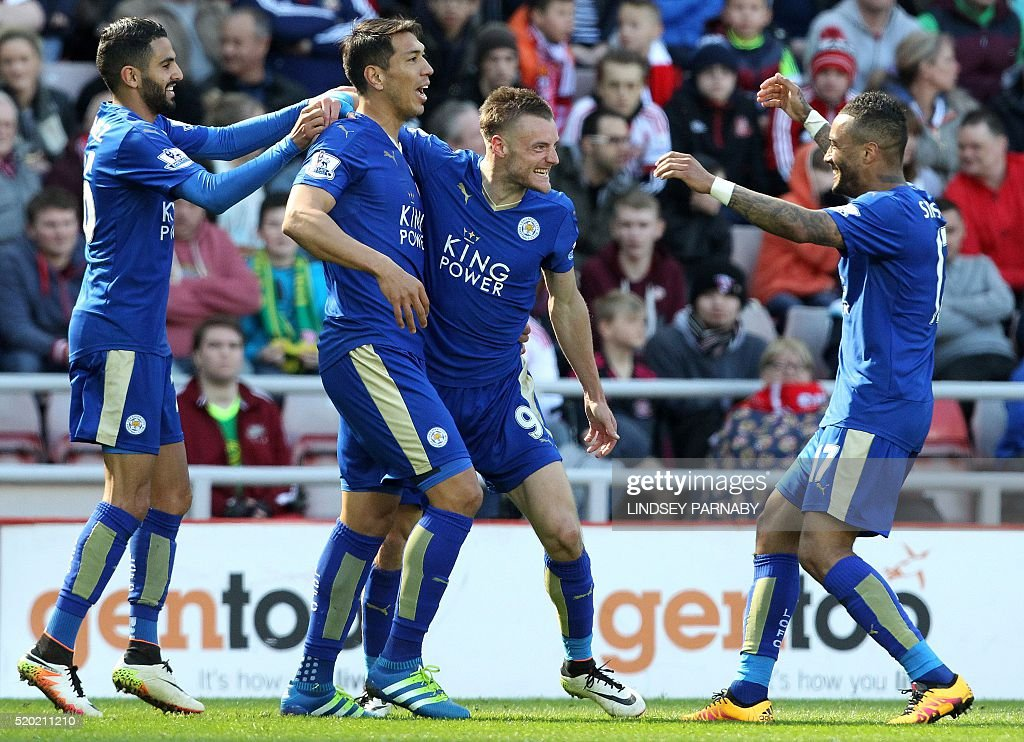 Leicester City's English striker Jamie Vardy (2R) celebrates scoring his team's first goal with Leicester City's Argentinian striker Leonardo Ulloa (2L), and Leicester City's Algerian midfielder Riyad Mahrez (L) and Leicester City's English defender Danny Simpson during the English Premier League football match between Sunderland and Leicester City at the Stadium of Light in Sunderland, northeast England on April 10, 2016. / AFP / LINDSEY PARNABY / RESTRICTED TO EDITORIAL USE. No use with unauthorized audio, video, data, fixture lists, club/league logos or 'live' services. Online in-match use limited to 75 images, no video emulation. No use in betting, games or single club/league/player publications. /