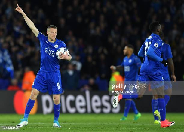 Leicester City's English striker Jamie Vardy celebrates scoring his team's first goal during the UEFA Champions League quarterfinal second leg...