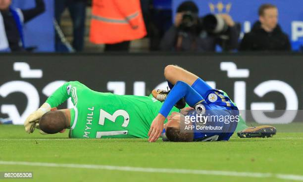 Leicester City's English striker Jamie Vardy clashes with West Bromwich Albion's USborn Welsh goalkeeper Boaz Myhill during the English Premier...