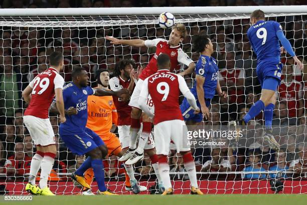 Leicester City's English striker Jamie Vardy heads home their third goal during the English Premier League football match between Arsenal and...