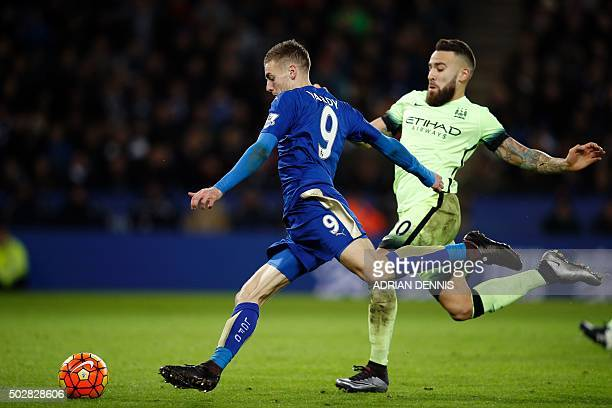 Leicester City's English striker Jamie Vardy prepares to shoot as Manchester City's Argentinian defender Nicolas Otamendi closes in during the...