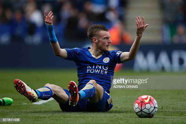Leicester City's English striker Jamie Vardy reacts after going down in the box under pressure from West Ham United's Italian defender Angelo Ogbonna...