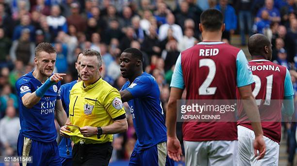 Leicester City's English striker Jamie Vardy reacts after referee Jonathan Moss showed Vardy his second yellow card for simulation to send him off...