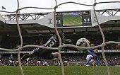 Leicester City's English striker Jamie Vardy scores his goal past Tottenham Hotspur's Dutch goalkeeper Michel Vorm during the English Premier League...