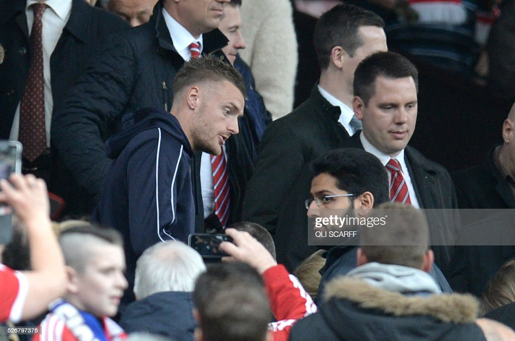 Leicester City's English striker Jamie Vardy (L), suspended for this match, arrives to watch the English Premier League football match between Manchester United and Leicester City at Old Trafford in Manchester, north west England, on May 1, 2016. / AFP / OLI SCARFF / RESTRICTED TO EDITORIAL USE. No use with unauthorized audio, video, data, fixture lists, club/league logos or 'live' services. Online in-match use limited to 75 images, no video emulation. No use in betting, games or single club/league/player publications. /