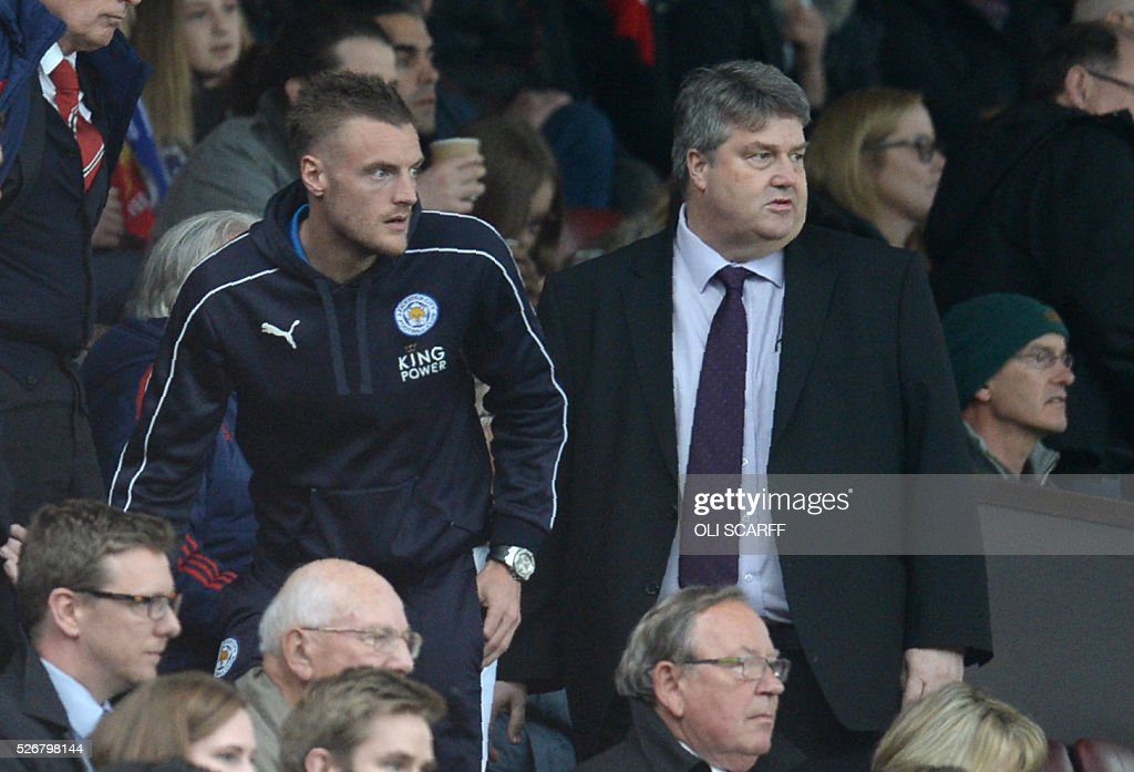 Leicester City's English striker Jamie Vardy (L), suspended for this match, finds his seat to watch the English Premier League football match between Manchester United and Leicester City at Old Trafford in Manchester, north west England, on May 1, 2016. / AFP / OLI SCARFF / RESTRICTED TO EDITORIAL USE. No use with unauthorized audio, video, data, fixture lists, club/league logos or 'live' services. Online in-match use limited to 75 images, no video emulation. No use in betting, games or single club/league/player publications. /