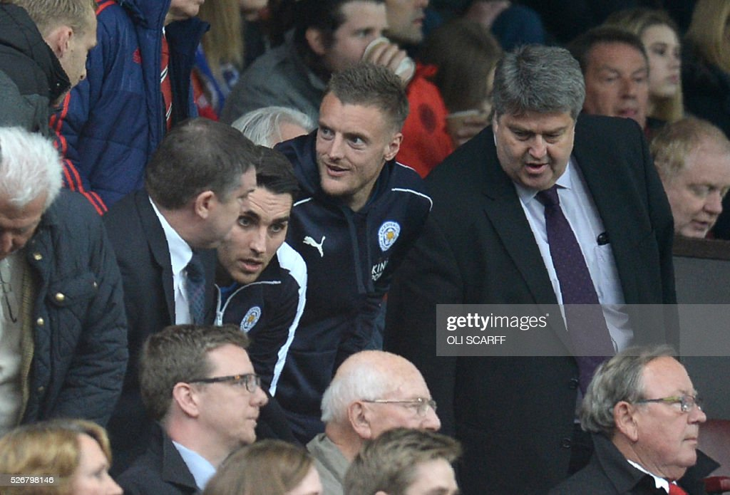 Leicester City's English striker Jamie Vardy (C), suspended for this match, finds his seat to watch the English Premier League football match between Manchester United and Leicester City at Old Trafford in Manchester, north west England, on May 1, 2016. / AFP / OLI SCARFF / RESTRICTED TO EDITORIAL USE. No use with unauthorized audio, video, data, fixture lists, club/league logos or 'live' services. Online in-match use limited to 75 images, no video emulation. No use in betting, games or single club/league/player publications. /