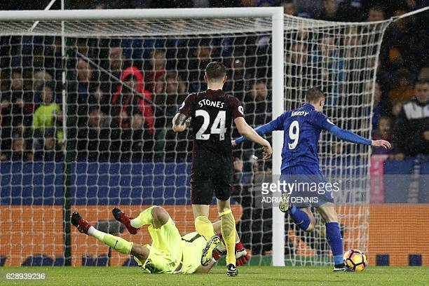 Leicester City's English striker Jamie Vardy takes the ball around Manchester City's Chilean goalkeeper Claudio Bravo on his way to scoring their...