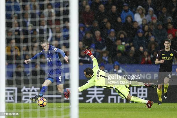 Leicester City's English striker Jamie Vardy takes the ball around Manchester City's Chilean goalkeeper Claudio Bravo on his way to scoring his third...