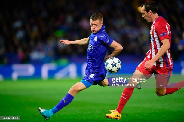 Leicester City's English striker Jamie Vardy vies with Atletico Madrid's Uruguayan defender Diego Godin during the UEFA Champions League quarterfinal...
