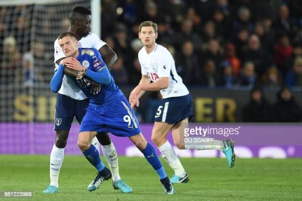 Leicester City's English striker Jamie Vardy vies with Tottenham Hotspur's Colombian defender Davinson Sanchez during the English Premier League...