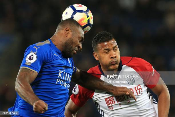 Leicester City's Englishborn Jamaican defender Wes Morgan and West Bromwich Albion's Venezuelan striker Salomon Rondon vie for the ball during the...