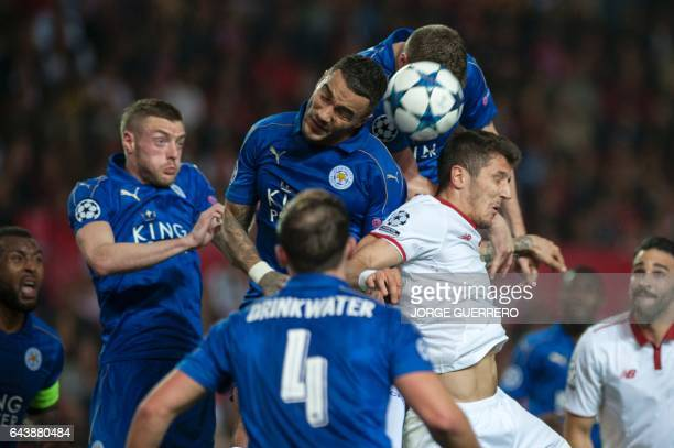 Leicester City's forward Jamie Vardy and Leicester City's defender Danny Simpson vies with Sevilla's defender Sergio Escudero during the UEFA...