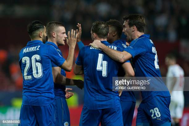 Leicester City's forward Jamie Vardy celebrates after scoring during the UEFA Champions League round of 16 second leg football match Sevilla FC vs...