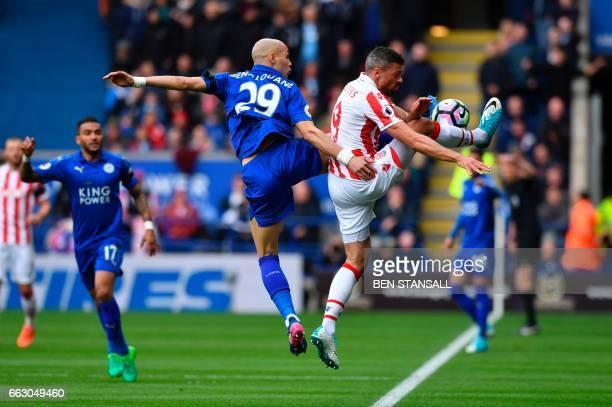 TOPSHOT Leicester City's French defender Yohan Benalouane vies with Stoke City's Englishborn Irish striker Jonathan Walters during the English...