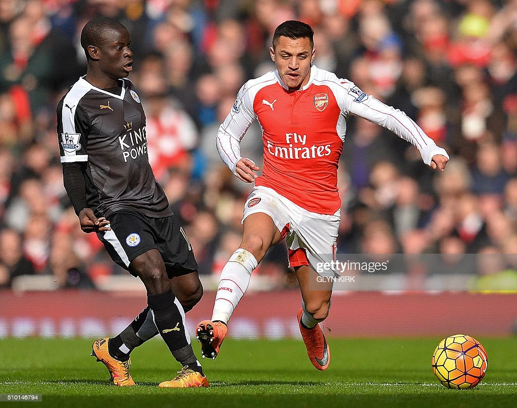 Leicester City's French midfielder N'Golo Kante (L) vies with Arsenal's Chilean striker Alexis Sanchez during the English Premier League football match between Arsenal and Leicester at the Emirates Stadium in London on February 14, 2016. / AFP / GLYN KIRK / RESTRICTED TO EDITORIAL USE. No use with unauthorized audio, video, data, fixture lists, club/league logos or 'live' services. Online in-match use limited to 75 images, no video emulation. No use in betting, games or single club/league/player publications. /