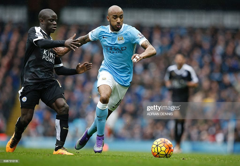 Leicester City's French midfielder N'Golo Kante (L) vies with Manchester City's English midfielder Fabian Delph during the English Premier League football match between Manchester City and Leicester City at the Etihad Stadium in Manchester, north west England, on February 6, 2016. / AFP / ADRIAN DENNIS / RESTRICTED TO EDITORIAL USE. No use with unauthorized audio, video, data, fixture lists, club/league logos or 'live' services. Online in-match use limited to 75 images, no video emulation. No use in betting, games or single club/league/player publications. /