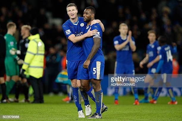 Leicester City's German defender Robert Huth and Leicester City's English defender Wes Morgan embrace after the English Premier League football match...