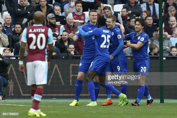 Leicester City's German defender Robert Huth celebrates after scoring their second goal during the English Premier League football match between West...