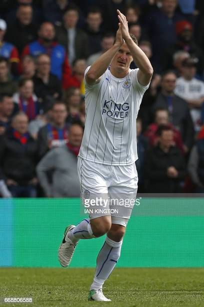 Leicester City's German defender Robert Huth celebrates after scoring the opening goal of the English Premier League football match between Crystal...
