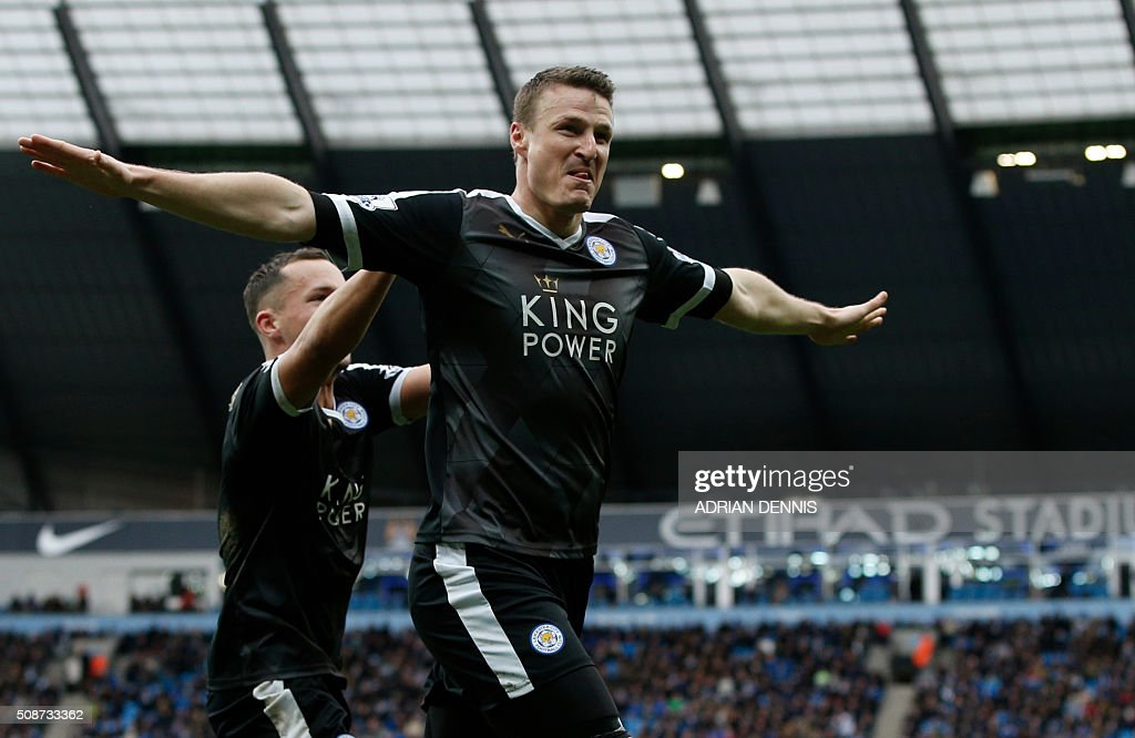 Leicester City's German defender Robert Huth celebrates scoring his team's third goal during the English Premier League football match between Manchester City and Leicester City at the Etihad Stadium in Manchester, north west England, on February 6, 2016. / AFP / ADRIAN DENNIS / RESTRICTED TO EDITORIAL USE. No use with unauthorized audio, video, data, fixture lists, club/league logos or 'live' services. Online in-match use limited to 75 images, no video emulation. No use in betting, games or single club/league/player publications. /