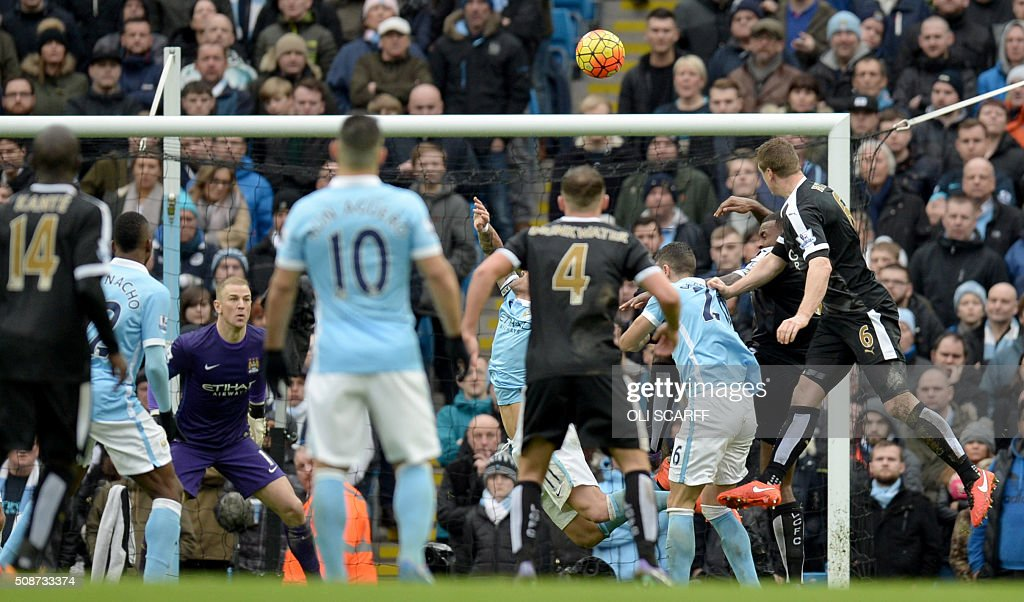 Leicester City's German defender Robert Huth (R) scores his team's third goal during the English Premier League football match between Manchester City and Leicester City at the Etihad Stadium in Manchester, north west England, on February 6, 2016. / AFP / OLI SCARFF / RESTRICTED TO EDITORIAL USE. No use with unauthorized audio, video, data, fixture lists, club/league logos or 'live' services. Online in-match use limited to 75 images, no video emulation. No use in betting, games or single club/league/player publications. /