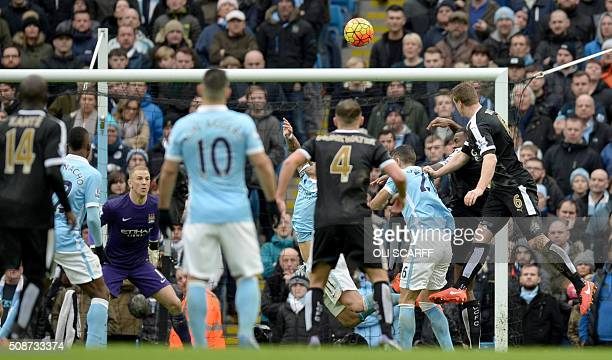 Leicester City's German defender Robert Huth scores his team's third goal during the English Premier League football match between Manchester City...