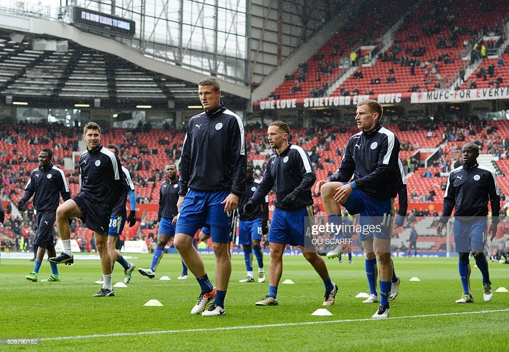 Leicester City's German defender Robert Huth (C) warms up before the English Premier League football match between Manchester United and Leicester City at Old Trafford in Manchester, north west England, on May 1, 2016. / AFP / OLI SCARFF / RESTRICTED TO EDITORIAL USE. No use with unauthorized audio, video, data, fixture lists, club/league logos or 'live' services. Online in-match use limited to 75 images, no video emulation. No use in betting, games or single club/league/player publications. /