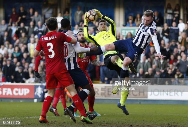 Leicester City's German goalkeeper RonRobert Zieler catches the ball under pressure from Millwall's Irish striker Aiden O'Brien during the English FA...