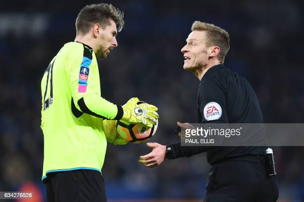 Leicester City's German goalkeeper RonRobert Zieler talks with referee Michael Jones about the ball during the English FA Cup fourth round replay...
