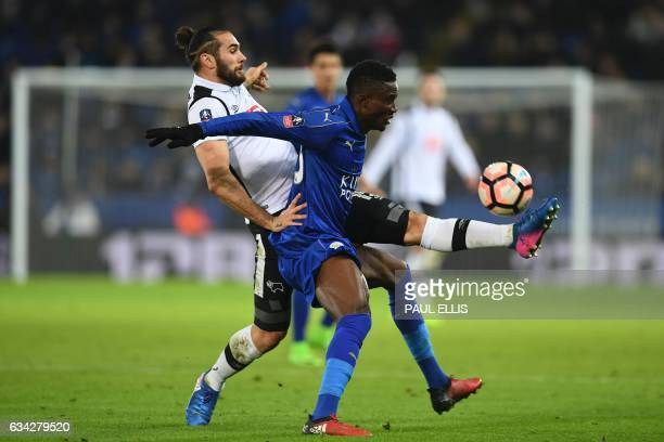Leicester City's Ghanaian midfielder Daniel Amartey tries to hold off Derby's English midfielder Bradley Johnson during the English FA Cup fourth...