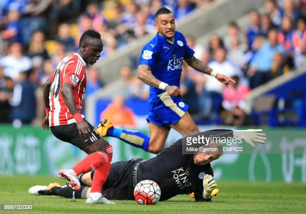 Leicester City's goalkeeper Kasper Schmeichel dives at the feet of Southampton's Sadio Mane