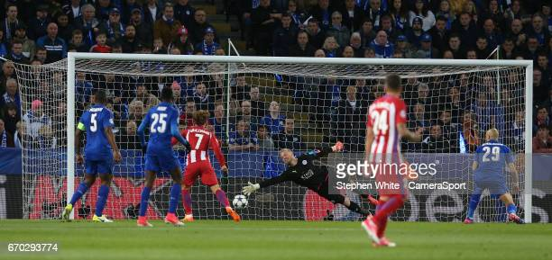 Leicester City's goalkeeper Kasper Schmeichel is beaten by the header of Atletico Madrid's Saul Niguez for the opening goal during the UEFA Champions...
