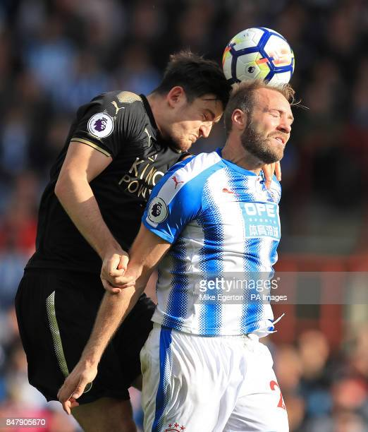 Leicester City's Harry Maguire and Huddersfield Town's Laurent Depoitre battle for the ball during the Premier League match at the John Smith's...