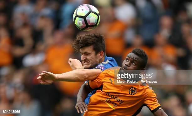 Leicester City's Harry Maguire battles for the ball with Wolverhampton Wanderers' Bright Enobakhare during the preseason match at Molineux...