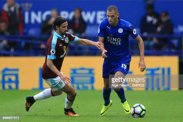 Leicester City's Islam Slimani and Burnley's George Boyd battle for the ball