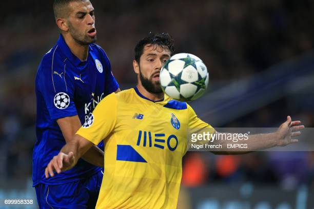 Leicester City's Islam Slimani and FC Porto's Augusto Felipe battle for the ball
